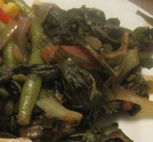 Swiss chard, green beans, garlic scapes, onions, stew